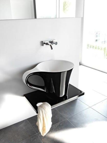 Diseño de lavatorio con forma de taza y plato
