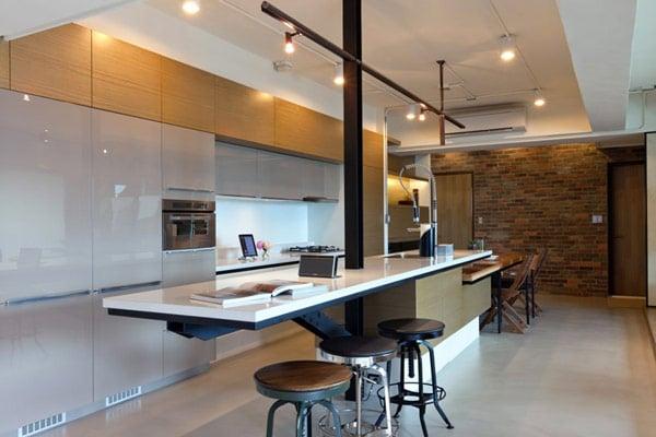 Dise o de apartamento en un almac n loft moderno for Cocina industrial tipo loft