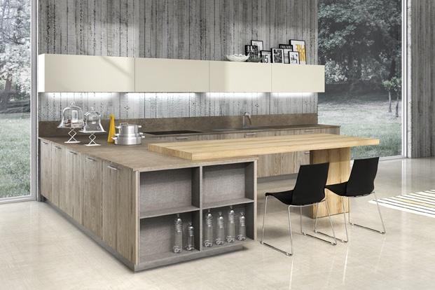 Dise o de cocinas elegantes combina l neas simples en for Cocinas con peninsula y mesa