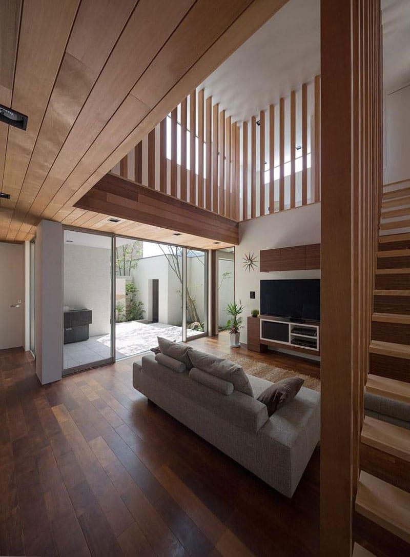 Dise o de moderna casa de dos plantas con planos de vivienda for Escaleras de sala