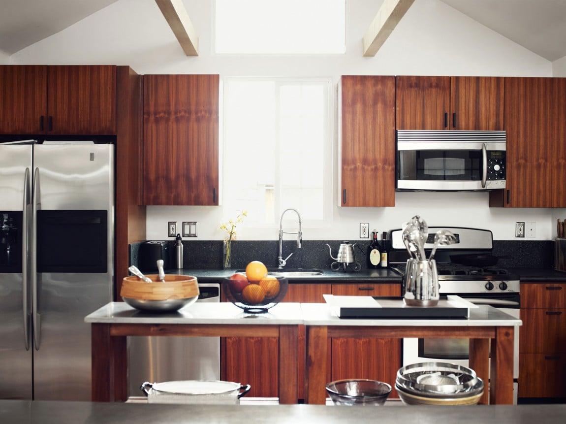 Dise o de casa muy peque a de madera fachada e for Casa minimalista interior cocina