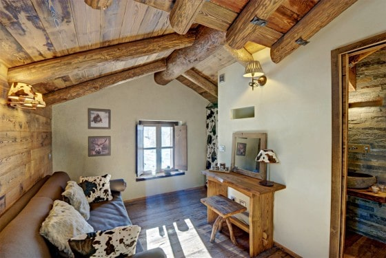 Dise o de interiores r stico uso de madera y piedra for Interior de la casa de madera moderna
