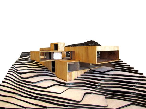 Maqueta de moderna casa en la montaña