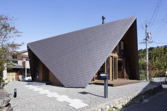 Perspectiva de casa con techo estilo origami
