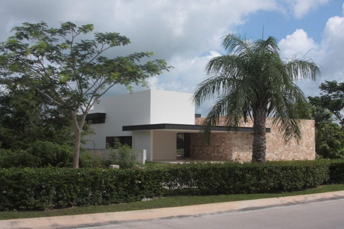 Dise o de casa en forma de l moderna fachada e interiores for Diseno de casas pequenas exteriores