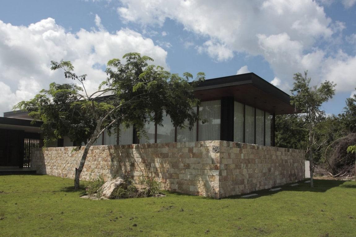Dise o de casa en forma de l moderna fachada e interiores - Fachada de piedra ...