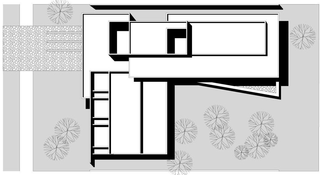 Dise o de casa en forma de l moderna fachada e interiores for Techos planos para casas