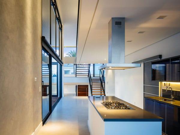 Dise o de moderna casa de dos pisos con fachada y planos for Diseno de cocinas minimalista