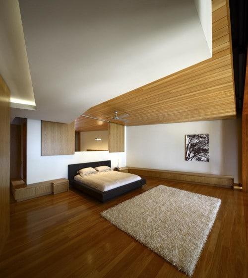 Diseño de dormitorio con techo de madera