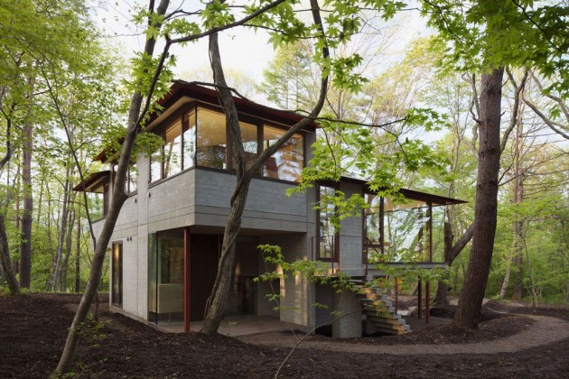Dise o de casa de campo moderna construida en concreto for Casa moderna en el campo