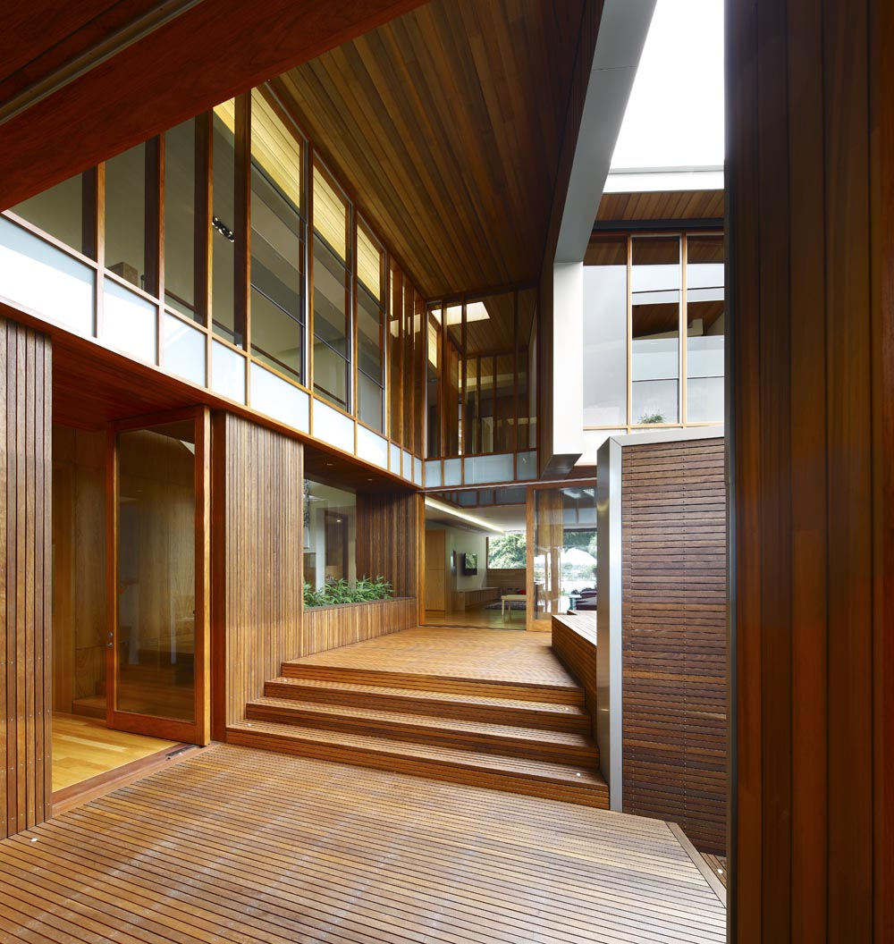 Dise o de casa moderna de dos plantas fachada e interiores for Interior de la casa de madera moderna