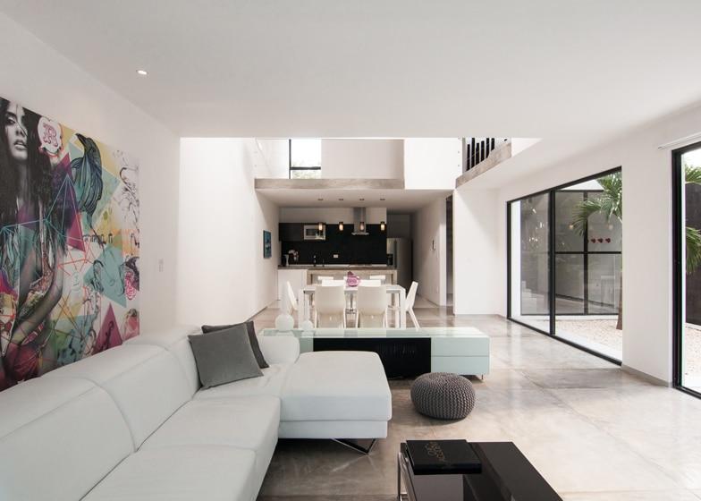 Dise o de casa minimalista de dos pisos planos y fachadas for Sala de estar y comedor