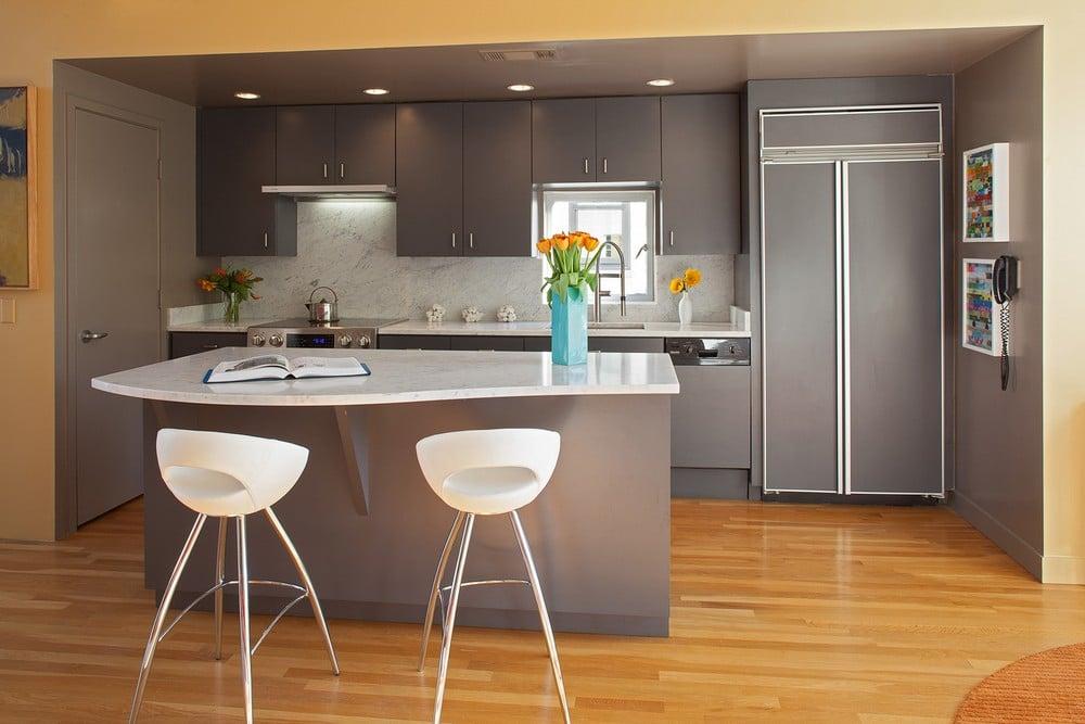 Dise o de casa ubicada en esquina moderna construye hogar for Islas de cocinas modernas con desayunador