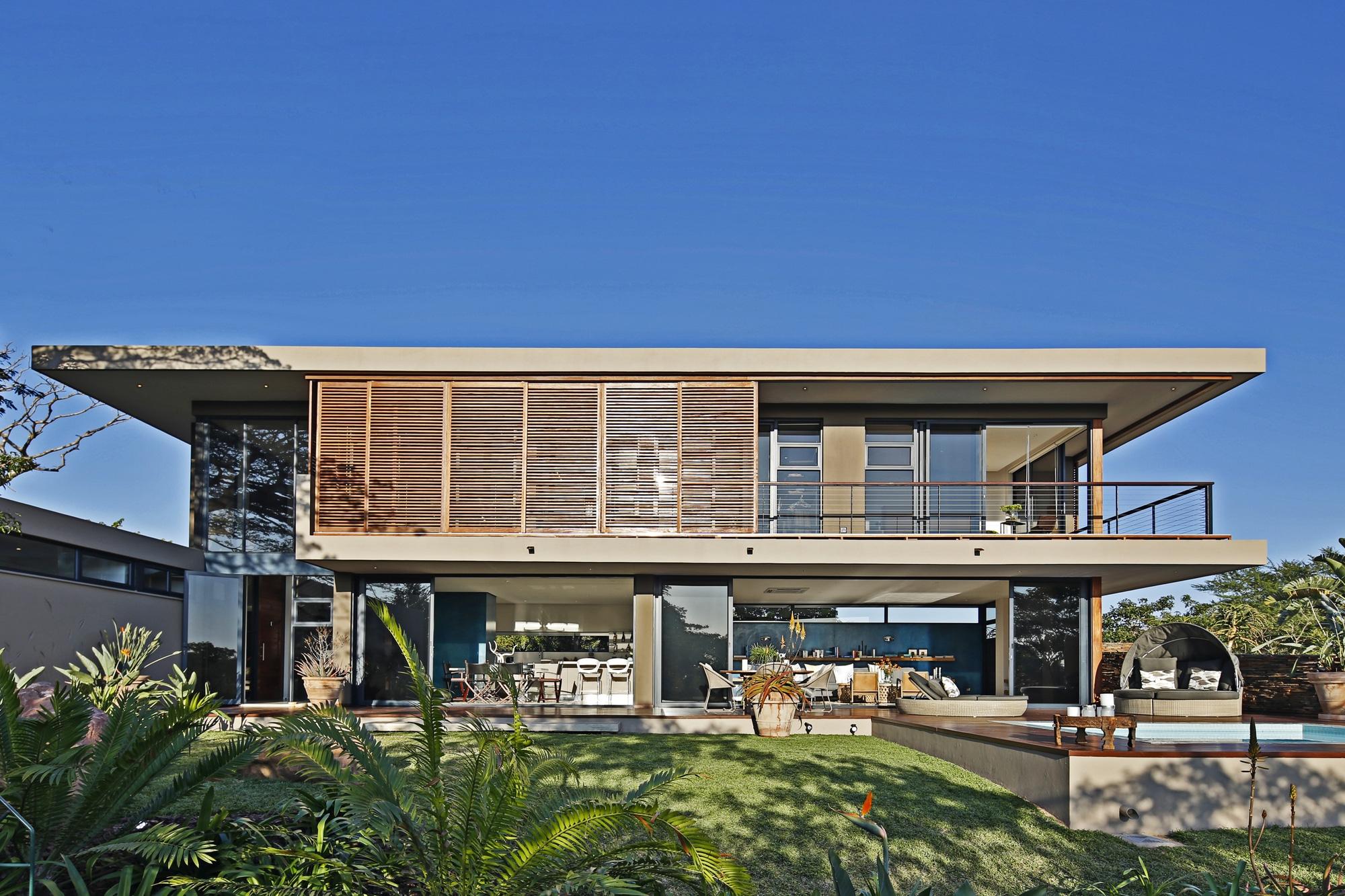 Casa moderna de dos pisos con planos for Casa moderna l