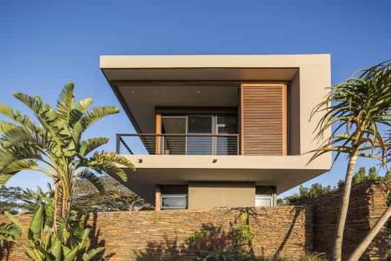 Vista lateral de vivienda de dos pisos