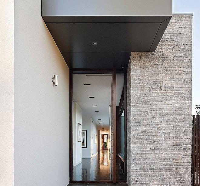 Dise o de casa moderna en esquina fachada e interiores for Diseno de entradas principales de casas
