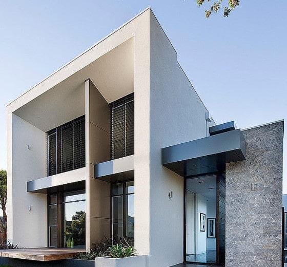 Dise o de casa moderna en esquina fachada e interiores for Diseno de hogares