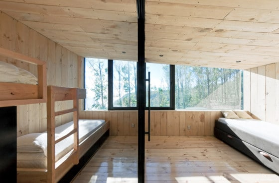 Diseño de dormitorios con paredes y techos de madera