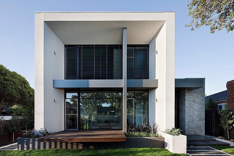 Dise o de casa moderna en esquina fachada e interiores for Fachadas de casas modernas pequenas de 2 pisos