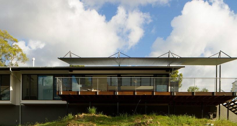 10 dise os de casas de una planta construye hogar for Fachada casa 2 plantas