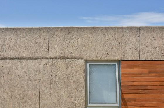 Detalles de fachada hormigón y madera
