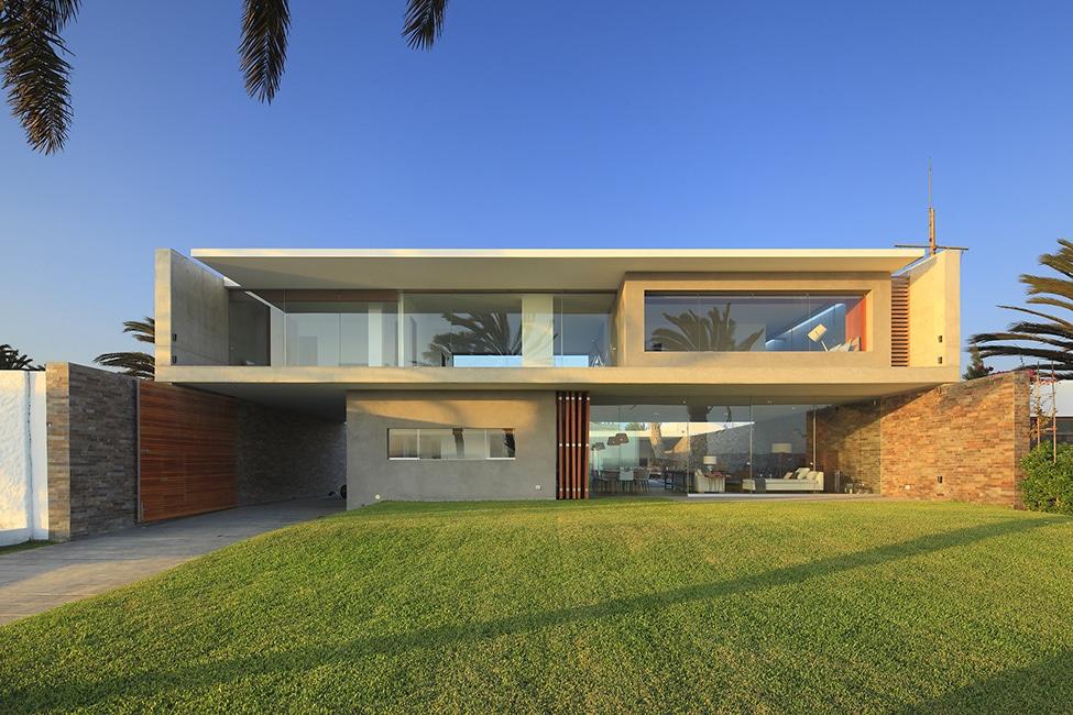 Fachadas de casa moderna de dos plantas construye hogar for Disenos de casas 10x20