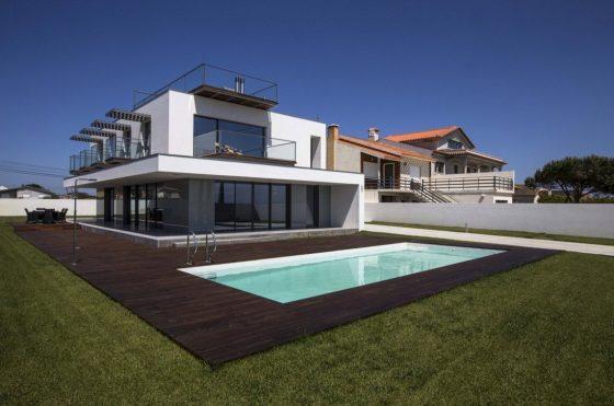 Diseño de casa de dos pisos con piscina