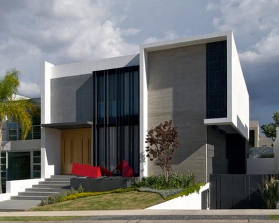 Fachada de casa moderna de dos plantas con sótano