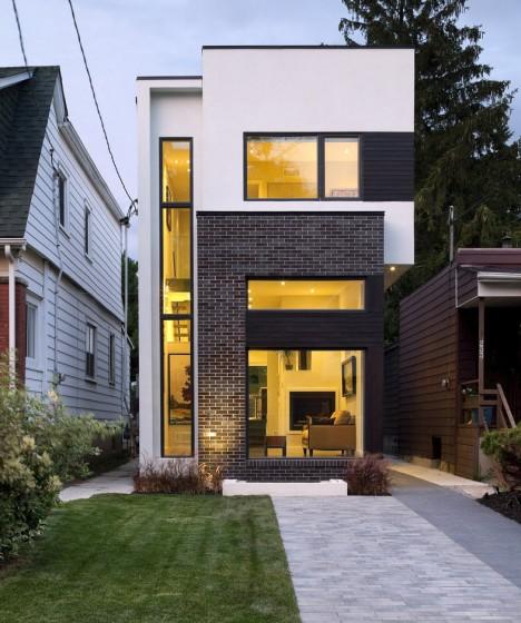 Fachada de casa moderna de dos pisos con sótano