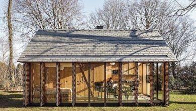 Photo of Diseño de pequeña cabaña de  madera que se abre al exterior para tener las mejores visuales