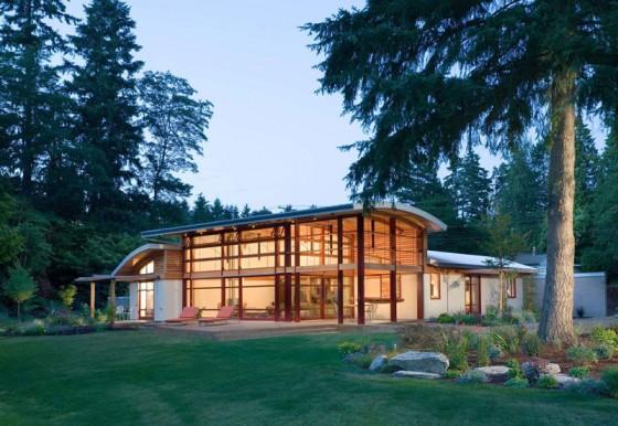 Diseño de casa de campo de un piso con techo a doble altura