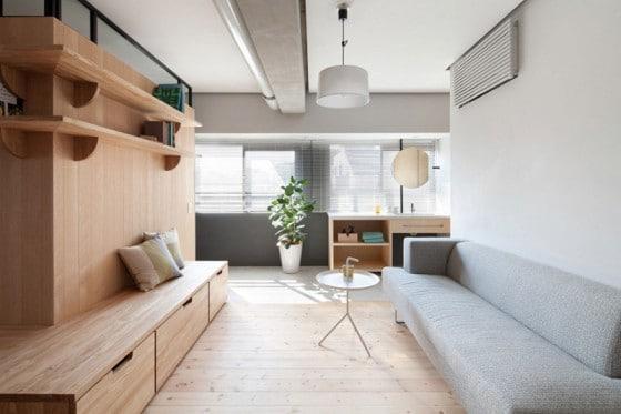 Diseño de sala con muebles y paredes de madera