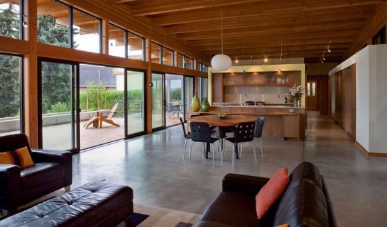 Diseño de cocina comedor y sala de casa de madera