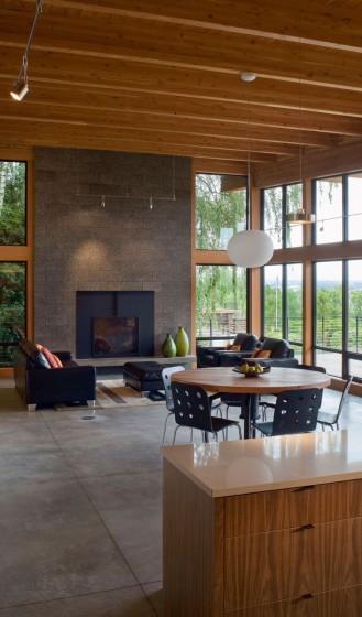 Diseño de sala con chimenea moderna de piedra gris