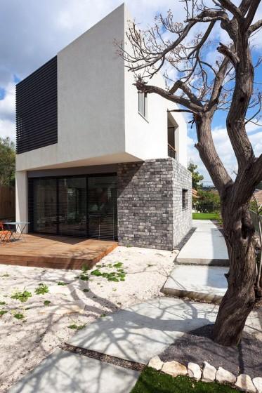 Diseño de casa  moderna de dos plantas con aplicaciones piedra