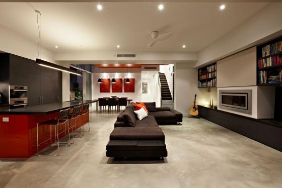Diseño de  interiores de sala moderna tonos rojos, grises y blancos
