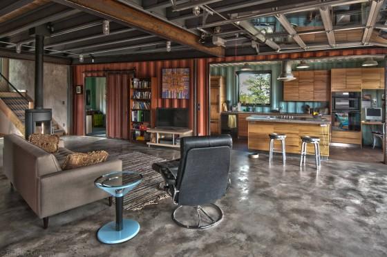 Diseño de interiores estilo industrial de casa containers