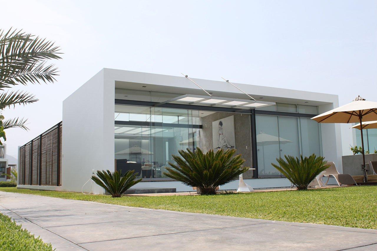 Dise o de casa de playa peque a planos for Fachada de casa moderna de un piso