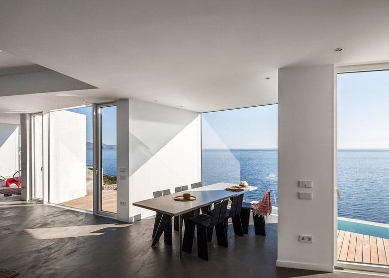 Dise o de casa de playa de dos pisos construye hogar for Sala girasol