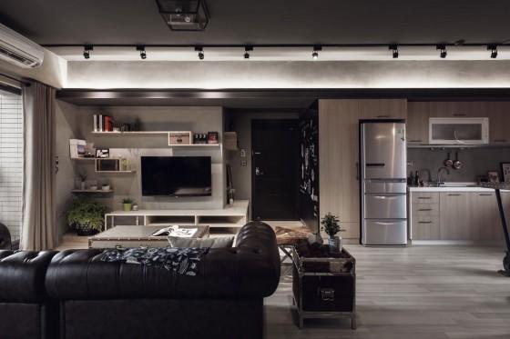 Diseño de sala de departamento con paredes de hormigón