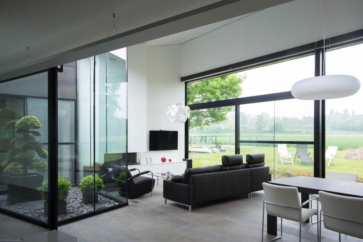 Casa moderna de un piso con fachada piedra construye hogar for Decoracion de casas minimalistas pequenas