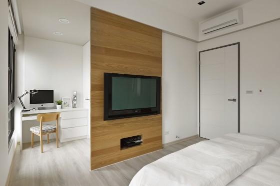 Dormitorio con pequeño cuarto de estudio