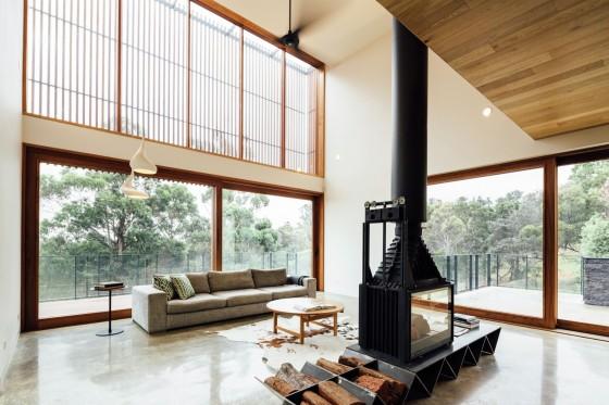 Sala con chimenea casa campo moderna