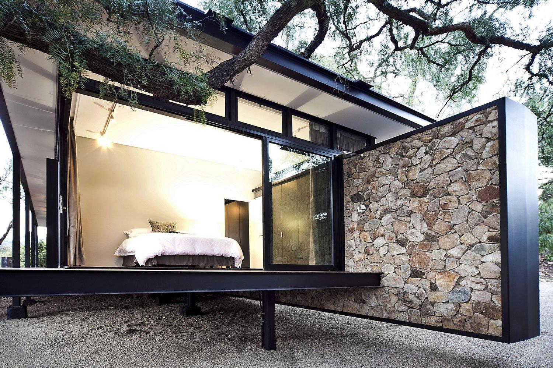 Moderna casa de campo con estructura acero construye hogar for Casa moderna black walnut luxury vinyl plank