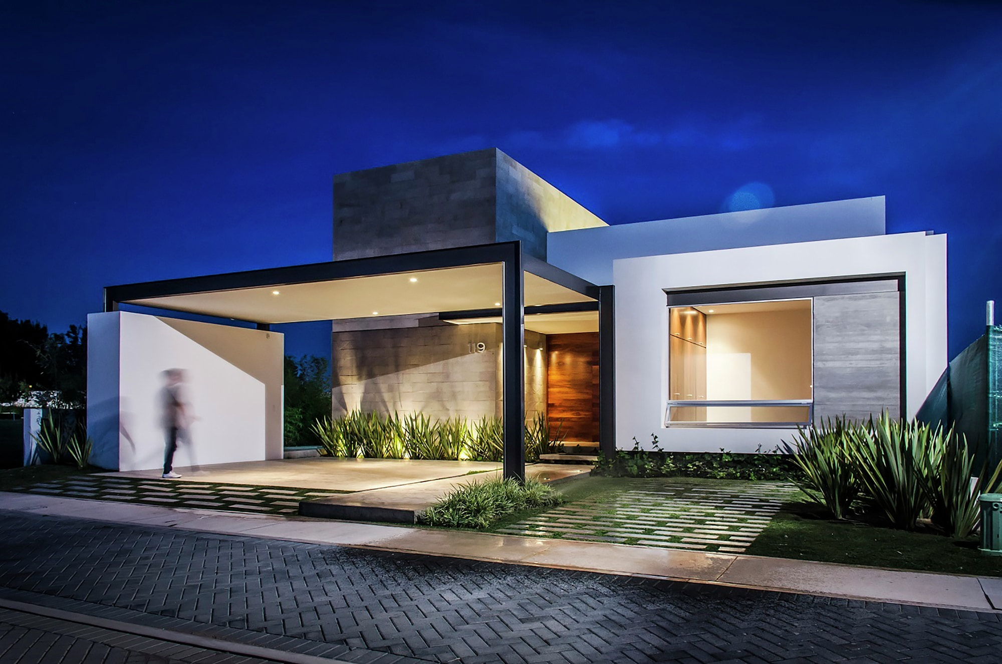 Dise o casa moderna de un piso construye hogar for Disenos para frentes de casas