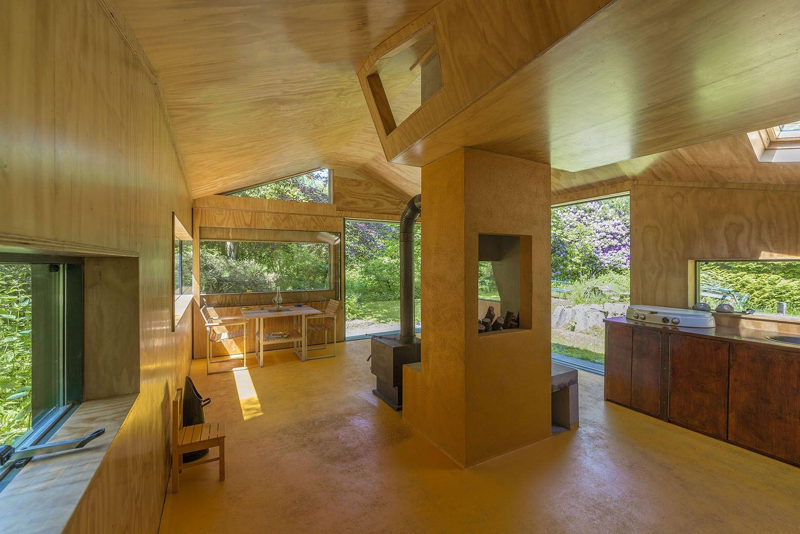 Dise o de caba a peque a de 35 metros cuadrados for Revestimiento interior madera