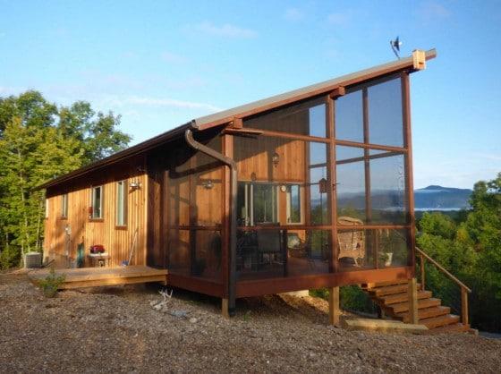 Diseño casa campo de madera con malla protectora insectos