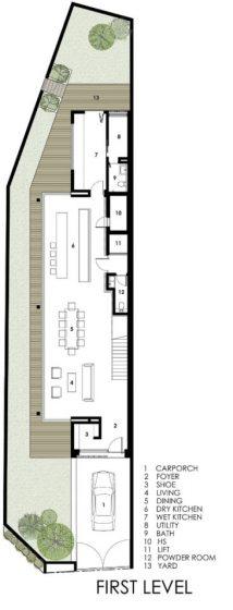 Casa de tres pisos angosta y larga