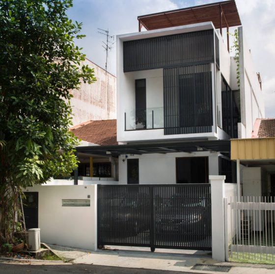 Fachada casa moderna angosta y larga
