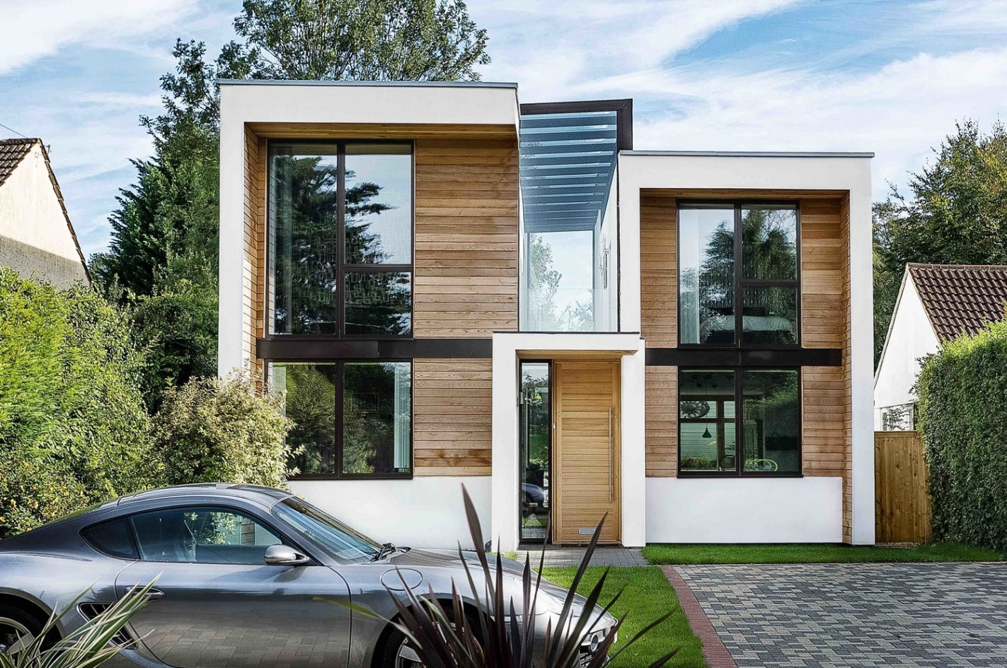 Dise o casa moderna de dos pisos construye hogar for Fachadas de viviendas modernas